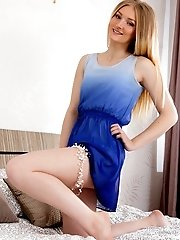 Sensual blonde teen in pigtails Dani Wild stripping pink lingeria and showing her awesome arse