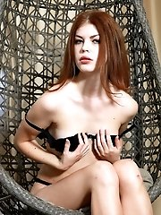 This Horny Doll Burs With Lust As She Hangs In Her Chair Where She Freely Embraces All Of Her Sexy F
