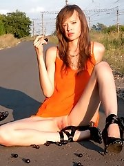 Gorgeous Slim Model Sexually Strips And Poses On A Road Letting You Admire Her Sweet Pussy.