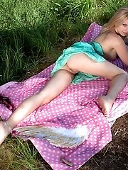 This Flawless Blonde Teen Starts Flapping Her Wings On The Lap Of Nature While She Is Showing Off He