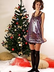 Graceful Teen Babe Strips Down Showing Off Her Alluring Naked Body By The Christmas Tree.
